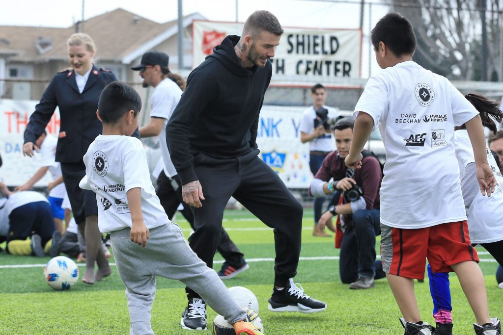 David-Beckham playing with kids from LA Galaxy Herbalife Event