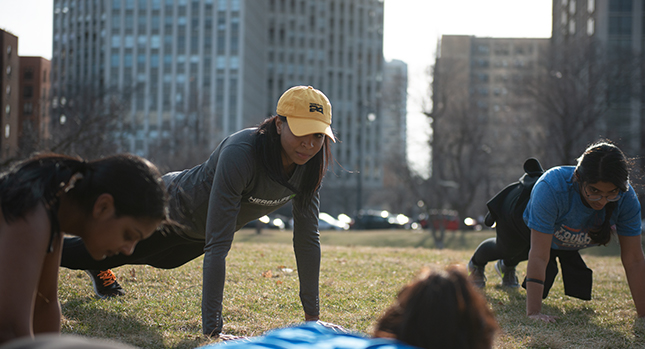 Meera leads a group workout