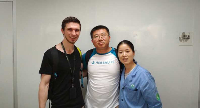 Adam Faller with Dr. Yanjun and another scientist