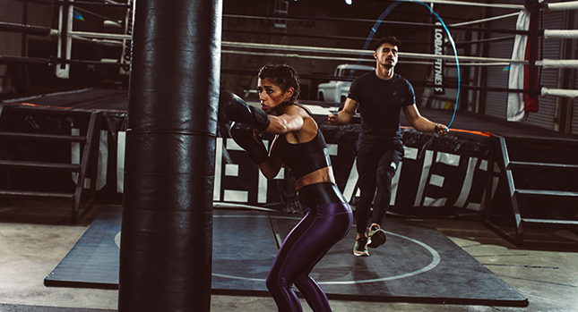Althetes training in a boxing gym