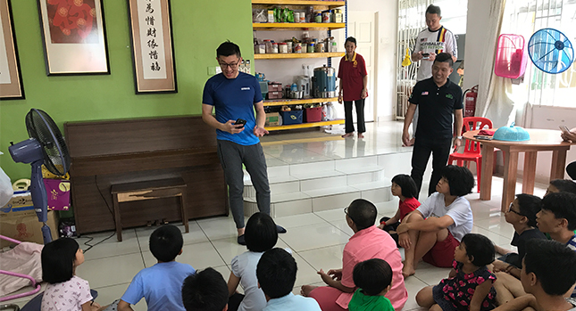 Kia Chun Loo regularly visits a local orphanage and shares engaging stories with the kids
