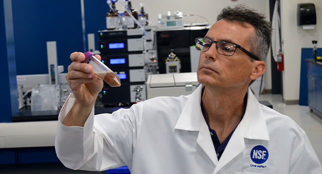 An NSF scientist tests a sports nutrition supplement product