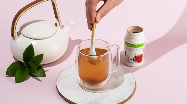 Making hot Herbalife tea
