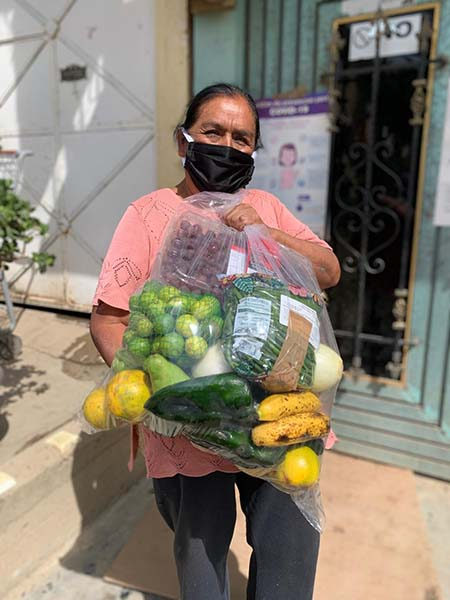 Mexican woman gets donations from food banks